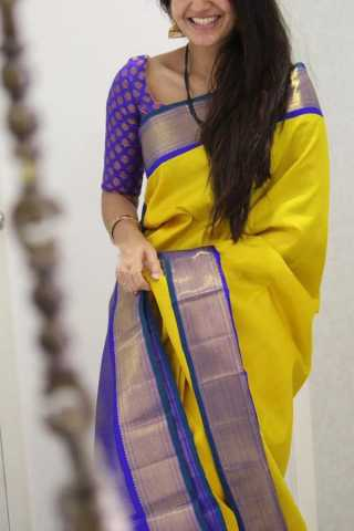 Graceful Yellow Colored Blue Border Soft Silk Party Wear Saree