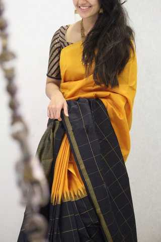 Sensational Yellow Colored Black Border Soft Silk Party Wear Saree