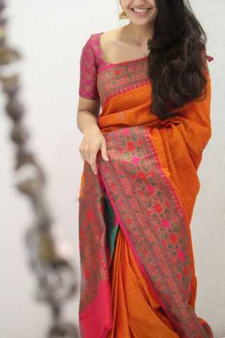Pretty Orange Colored Soft Silk Party Wear Saree