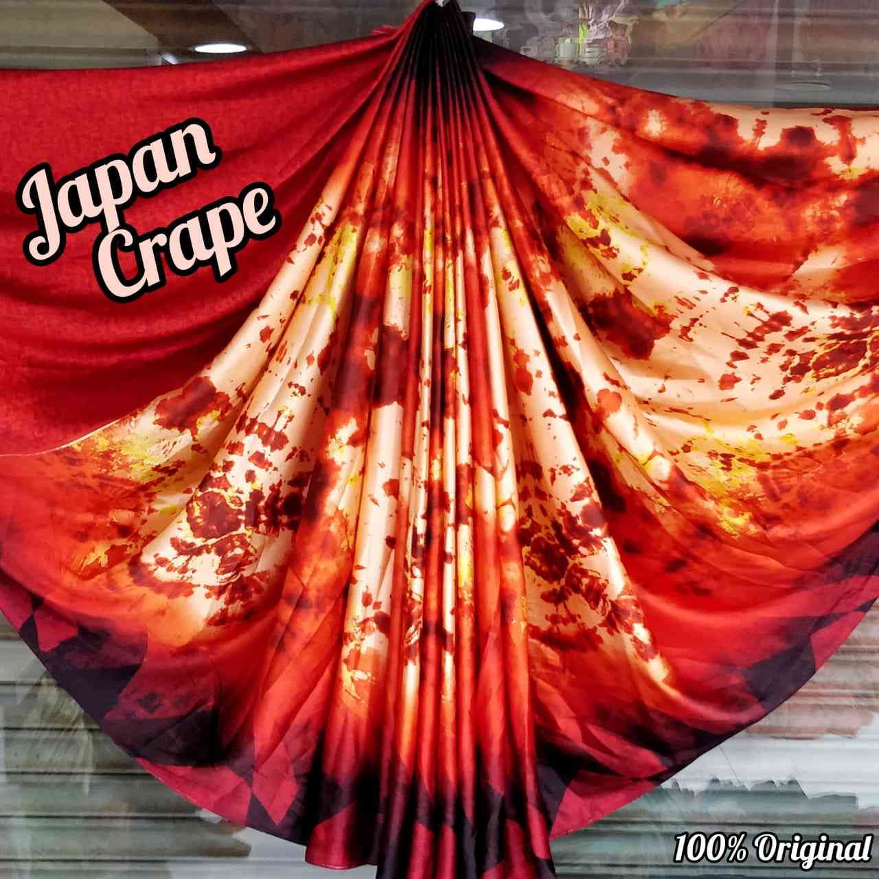 Designer Orange And Black Japan Crape Saree