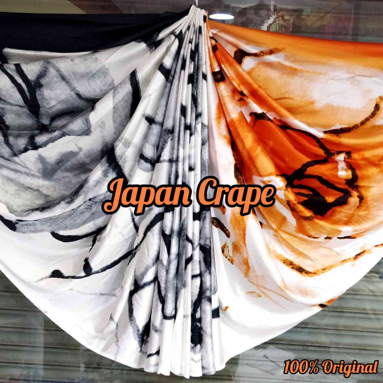 Designer Beige And Orange Japan Crape Saree