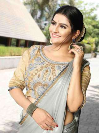 Plain silver saree with a ruffled lace border and matching blouse