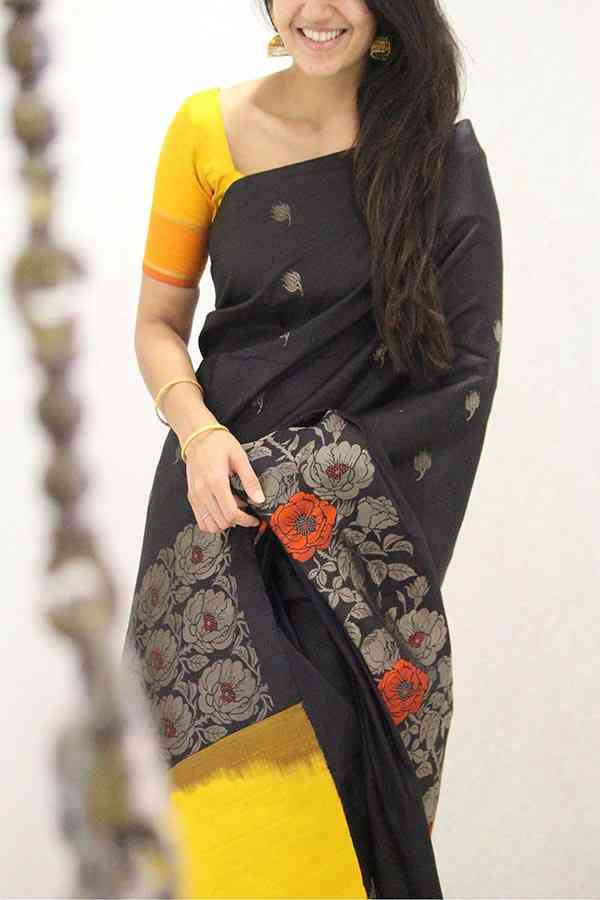 Mesmerising Yellow and Black Flower Border Silk Saree
